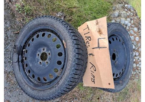 4 Studded Snow Tires on Rims